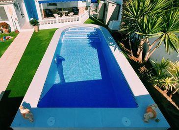 Semi-inground pool, completed. Built by Almeria Builders