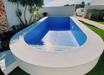 Alternative view of completed semi-inground pool. Built by Almeria Builders