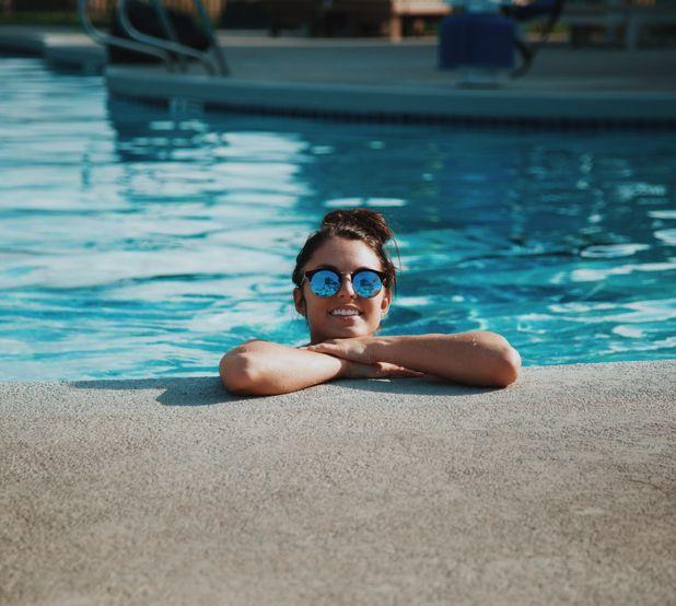 Almeria Builders - Woman smiling in a swimming pool